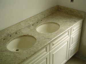 double ceramic round sink granite top onwhite paneled vanity